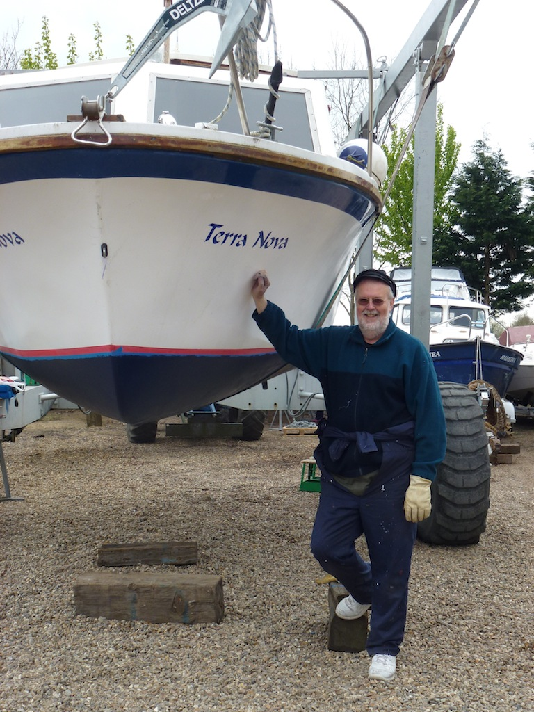 Mort Smith stands beside the bow of Terra Nova