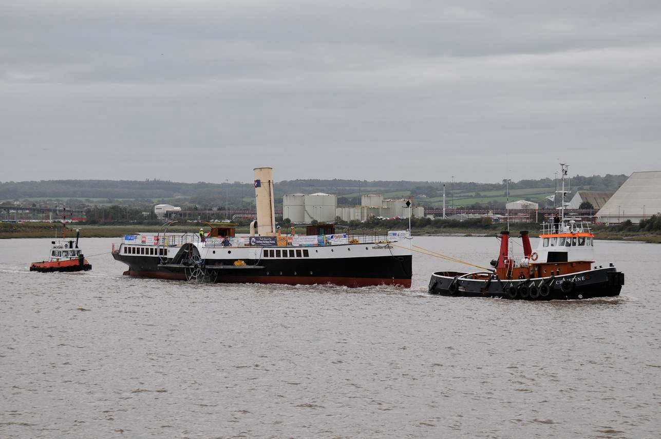The paddle steamer Medway Queen is towed out of Bristol Docks on her way back to the Medway