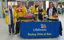 The team from the RNLI Egham and Virginia Water branch at their collection table in the Elmsleigh Centre, Staines. They raised more than £1,000 in a day